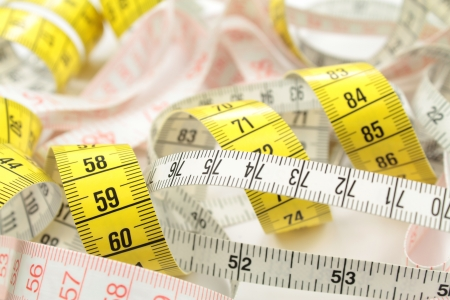 tailors tape: Various tape measure as background  Stock Photo