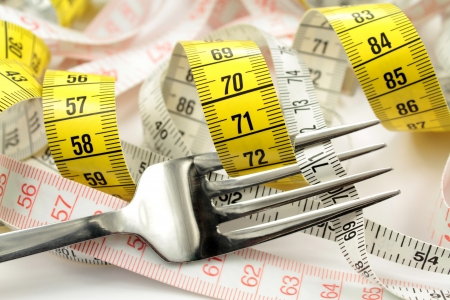 taylor: Various tape measure and fork   Diet concept  Stock Photo