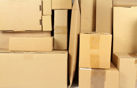 boxboard: Stacked carton boxes post package Stock Photo