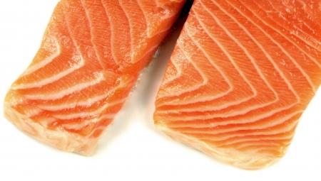 Fresh salmon fillet on white background- close up photo