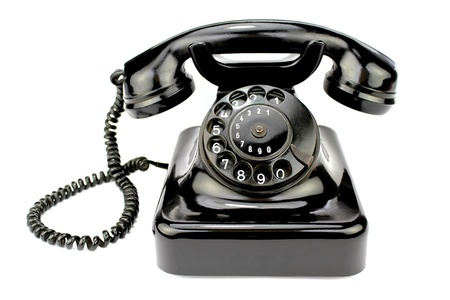 telephone line: Old rotary phone on white background.