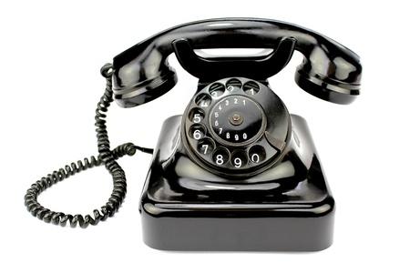 telefono antico: Vecchio telefono a disco su sfondo bianco.