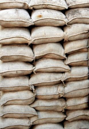 sackful: Stacked sandbags Stock Photo