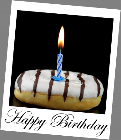 Donut and birthday candle on  polaroid photo look with sample text photo