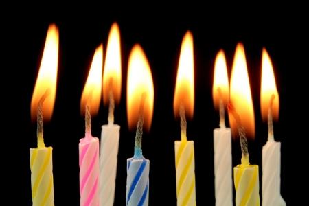 Birthday cake candles on black background  photo