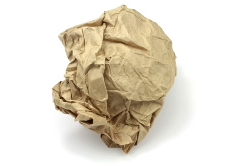 wastrel: Crumpled brown paper on white background