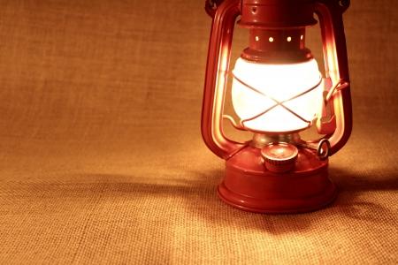 flame like: Oil lamp on burlap