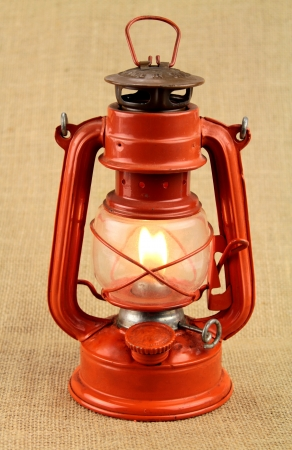 Red oil lamp on burlap Stock Photo - 16443721