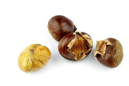 buckeye seed: Roasted chestnuts on white background Stock Photo