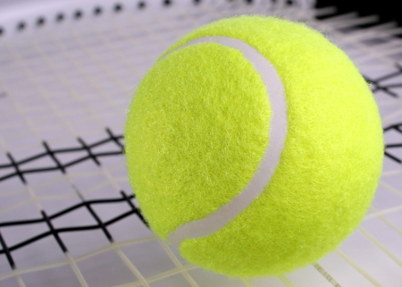 Tennis ball on racket photo