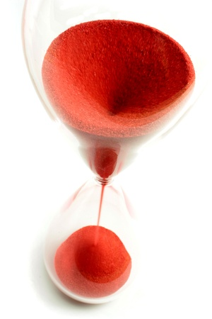 Hourglass with red sand and top view photo