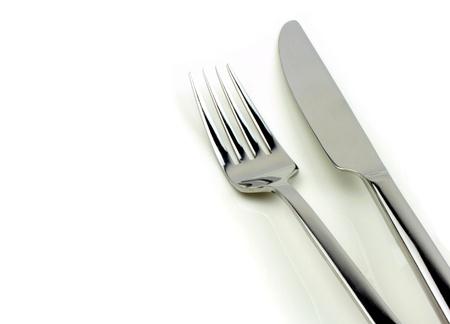 フォークとナイフ白い背景の上