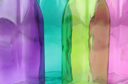 Colorful glass bottle background photo
