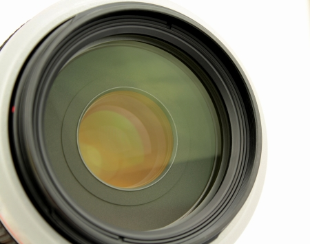 Camera lens on white background  photo