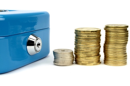 Cash box and stacked coins photo