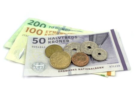 danish: Danish kroner, coins and banknotes on white background  Stock Photo