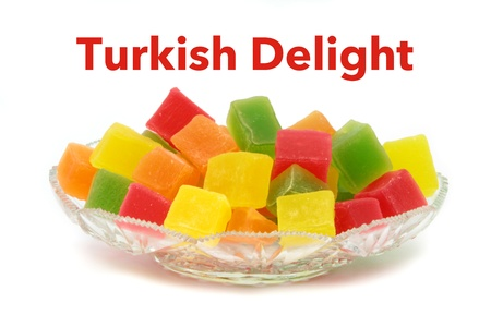 Colorful Turkish delight in crystal plate and sample text photo
