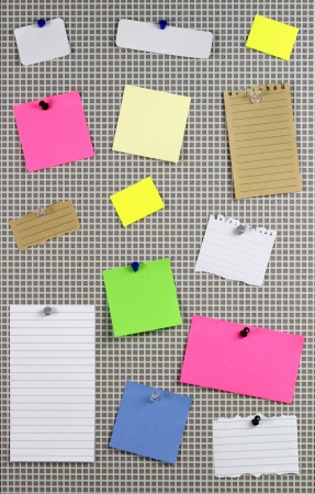 paper clips: Various note papers on cork board Stock Photo