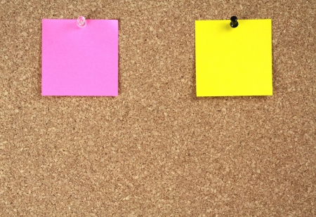 pink brown: Notice papers on cork board