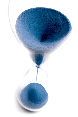 Hourglass with blue sand and top view