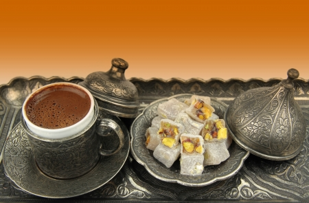 Turkish coffee and turkish delight with traditional embossed metal tray and cup  photo