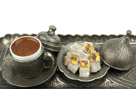 Turkish coffee and turkish delight with traditional embossed metal tray and cup  Stock Photo
