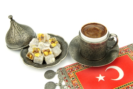 Turkish coffee and turkish delight on white background