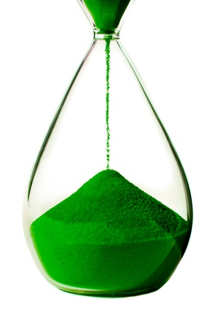 Green hourglass on white background photo