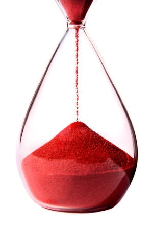 glasses in the sand: Red hourglass on white background