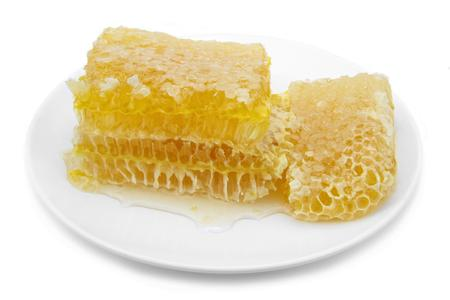 Delicious honeycombs on plate   photo