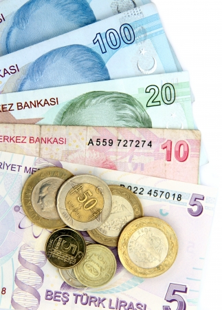 25 cents: Turkish banknotes and coins on white background