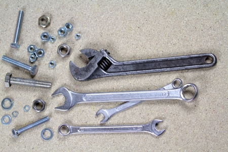 Wrench, monkey wrench and various bolts and nuts  photo