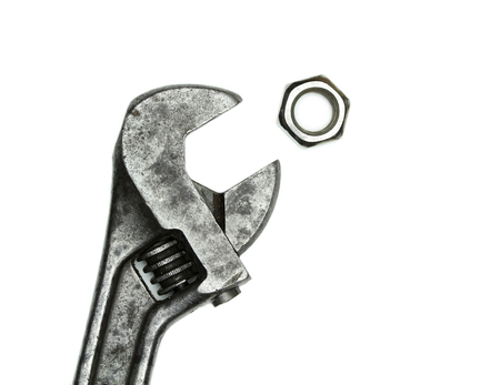 monkey nuts: Old monkey wrench and bolt nut on white background  Stock Photo