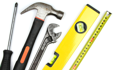 Various work tools on white background  Close up image   photo