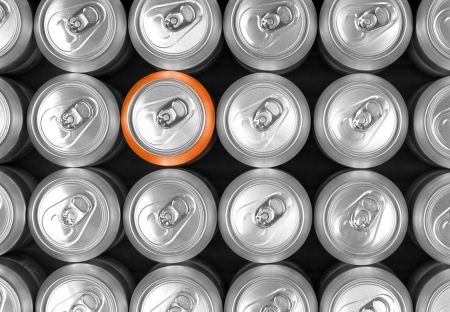 carbonated: Aluminum drink cans and one orange can  Difference concept