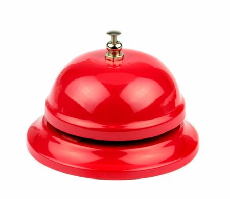 白い背景の赤いベル