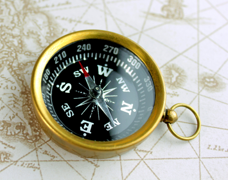 Old compass on map photo