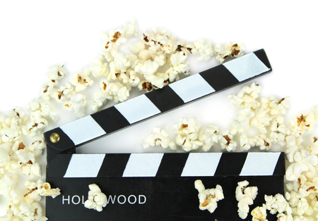 Popcorn and movie clapper , close up image photo