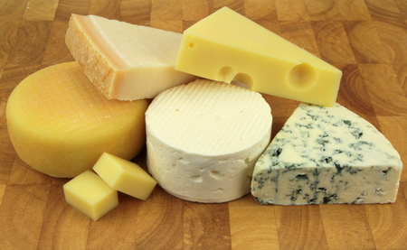 Various cheeses on a kitchen board photo
