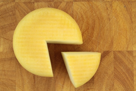 salut: Cheese on a kitchen board