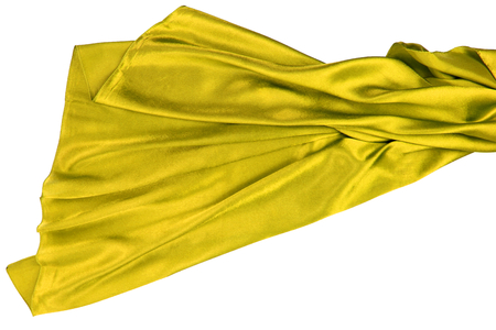 rippling: Yellow rippling silk fabric on white background
