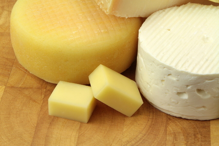 Various cheeses on wood background photo