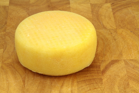 yellow block: Cheese on a kitchen board
