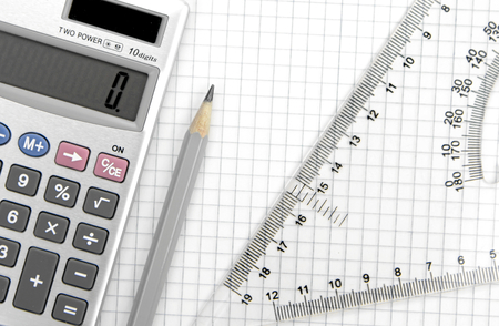 square ruler: Calculator, lead pencil and ruler on squared paper Stock Photo