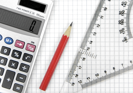 delineate: Calculator, lead pencil and ruler on squared paper Stock Photo