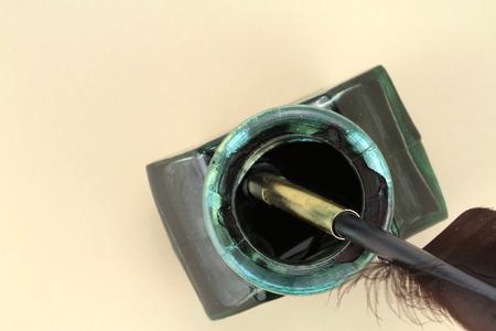 bygone: Quill pen in glass ink bottle