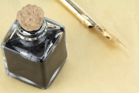 Quill pen and glass ink bottle photo