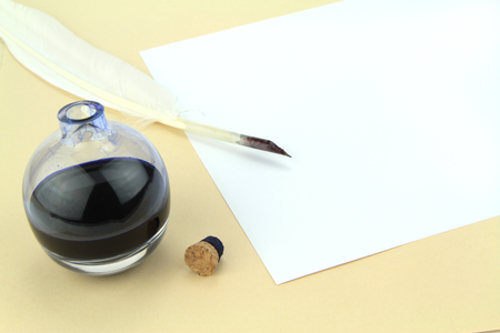 Quill pen in glass ink bottle photo
