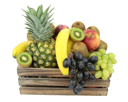 crate: Various fruits on white background  Stock Photo