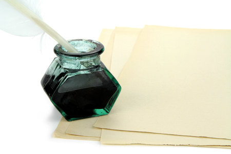 inkwell: Quill pen and glass ink bottle on paper Stock Photo